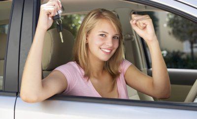 Teenage Girl Celebrating Owning First Car